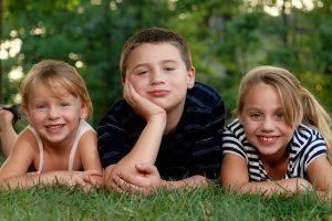 3 kids on lawn
