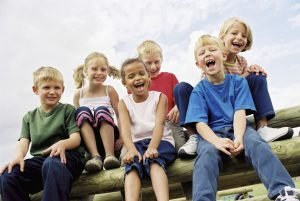 smiling group of children sitting