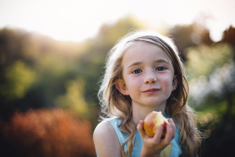 One child eating apple