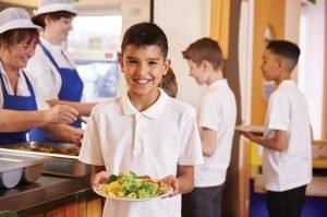 Boy eats healthy salad