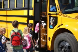 children boarding the school bus